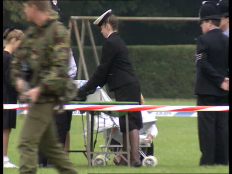 Duke of Edinburgh ENGLAND Kent Deal Barracks MS Entrance to barracks as police officer stands on guard soldiers on patrol inside as wreaths on ground...