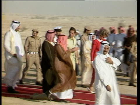 Day 6 QATAR Umm alGhadir Prince Charles along with officials in garden Crew in dhow boat Princess Diana in green dress along through playground with...