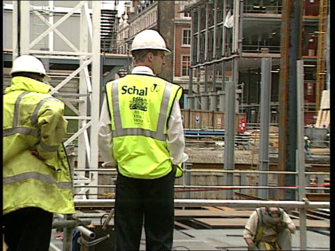 London Covent Garden CBV 'Royal Opera House' on back of man's luminous tabard OUT as he oversees redevelopment work Seq Builders at work LA GV Royal...