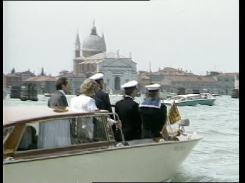 Day 15 ITALY Venice LMS Royal Yacht Britannia LR island of S Georgio Maggiore in the background MS St Marks AV Charles and Diana wave from balcony of...