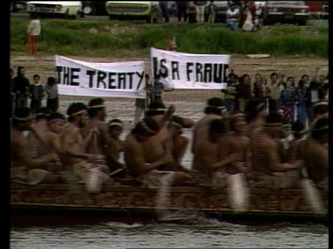 Royal tour Day 41 NEW ZEALAND Waitangi MS Prince Charles and the Princess of Wales RL TS Charles helps Diana into war canoe MS Sitting in canoe LS...
