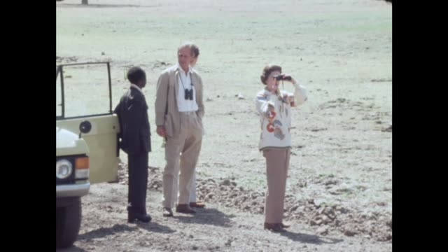 Luangwa Park MS Queen Elizabeth II and Binoculars MS Prince Philip and Prince Andrew MS Hippo MS Royals at car MS Press MS Royals at car Tx 30779/NAT...