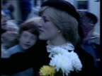 Brecon Princess of Wales and Prince Charles watching dancing MS Princess chats to children and takes flowers little one kisses her MS Butcher in...