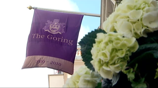 Arrivals and departures at Goring Hotel ENGLAND London Goring Hotel EXT General views of entrance to Goring Hotel / Goring Hotel flag with heraldic...