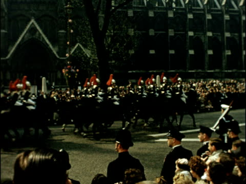 Colour footage of Princess Margaret's wedding to Antony Armstrong Jones Feet of cameraman and cables on ground Crowds waiting outside Westminster...
