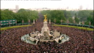 Royal wedding of Prince William and Kate Middleton ITV News Special PAB 1330 1430 Various of crowds outside Buckingham Palace and The Mall Some...