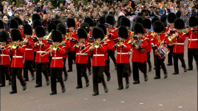 Royal wedding of Prince William and Kate Middleton ITV News Special PAB 0825 0930 Various views of marching band leaving Wellington Barracks past...