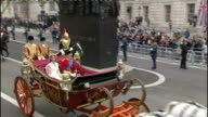 Royal wedding of Prince William and Kate Middleton ITV News Special PAB 1130 1230 SPLIT SCREEN Duke and Duchess of Cambridge waving to crwods on...