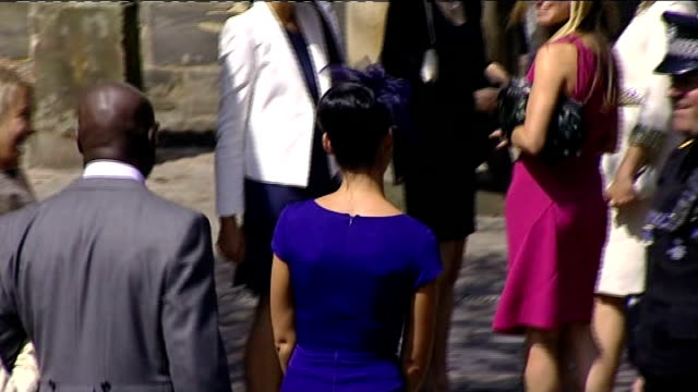 Royal wedding of Zara Phillips to Mike Tindall arrivals at church **Poor audio quality from here** Back view of more guests arriving / Tony McCoy...