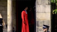 Royal wedding of Zara Phillips to Mike Tindall arrivals at church Bagpiper arriving / minister along outside church **Bagpipe music heard SOT**...