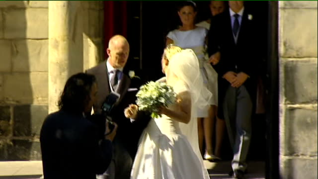 Royal wedding of Zara Phillips to Mike Tindall departures from church SCOTLAND Edinburgh Canongate Kirk EXT **Bagpipe music heard SOT** Zara Phillips...