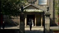 Royal wedding of Zara Phillips to Mike Tindall SCOTLAND Edinburgh Canongate Kirk EXT Long shot Zara Phillips and Mike Tindall out of church ZOOM IN...