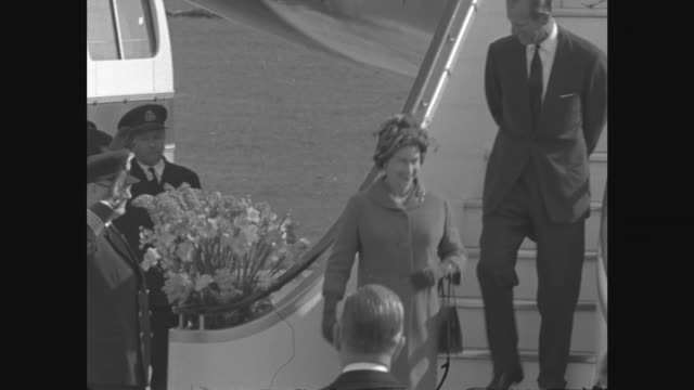 Royals arrive back in England after Tour of Australia ITN Queen and Duke down steps of plane and shake hands with ministers MS Queen Mother and...