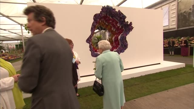 Royals at Chelsea Flower Show 2016 Queen along to chat with more guests and through flower displays / Queen looks at floral display in shape of her...