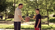 Royalty Free Stock Footage of Dad and son playing basketball.