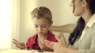 Royalty Free Stock Footage of Mother and child studying together at the kitchen table.