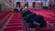 Royalty Free Stock Video Footage of kneeling muslim men filmed in Israel at 4k with Red.