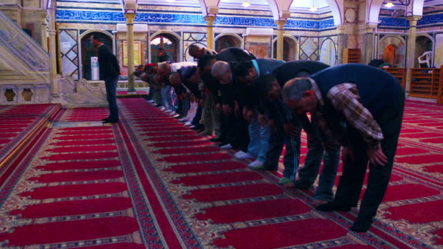 Royalty Free Stock Video Footage of muslim men praying at a mosque filmed in Israel at 4k with Red.