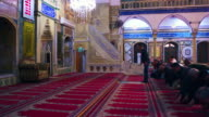 Royalty Free Stock Video Footage of praying at Jezzar Pasha Mosque filmed in Israel at 4k with Red.