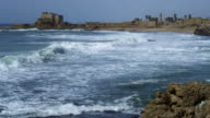 Royalty Free Stock Video Footage of waves and Caesarea shot in Israel at 4k with Red.