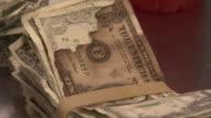 CU TU TD Rubber banding around stack of damaged money next to jar full of torn bills / Kansas City, Kansas, United States