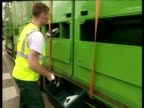 Rubbish collector empties recycling box contents into different sections of collection truck