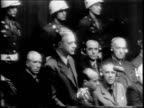 Rudolf Hess rises from seat and makes plea / view of officials in courtroom / Joachim von Ribbentrop rises and makes plea / Wilhelm Keitel rises and...