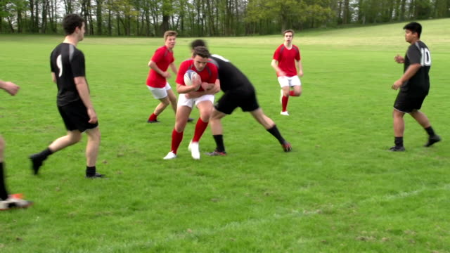 Rugby match action open play with two teams (Sport)