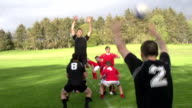 Rugby Match Lineout with ball thrown in by Hooker