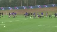 Rugby World Cup 2015 All Blacks training Players pairing up for training drills / whole squad stretching / whole team jogging along / planks on floor...