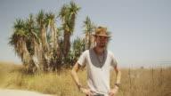 Rugged Hispanic man standing outdoors smiling