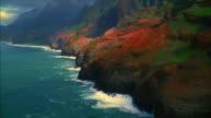 Rugged mountains meet an ocean coast on the island of Kauai. Available in HD.