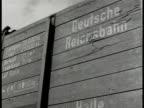 Ruhr Valley Germany WS Coal mining factory trains CU Train side 'Deutsche reichsbahn' CU Train w/ coal MS Steel mill smoke stacks INT Bessemer flames...