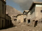 A ruined street in Plymouth Montserrat following the volcanic eruption of July 1997
