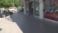 A runaway tyre hits local pharmacy and get inside in Adana Turkey on April 18 2017 CCTV footage shows that The footage shows a three man chatting in...