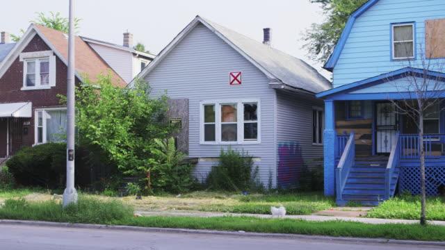 WS Run-down house with broken windows day