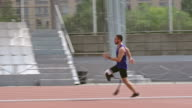 Runner with prosthetic leg competing on track