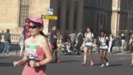 Runners at rue de Rivoli in front of Louvre during the sport event Paris Marathon 2017