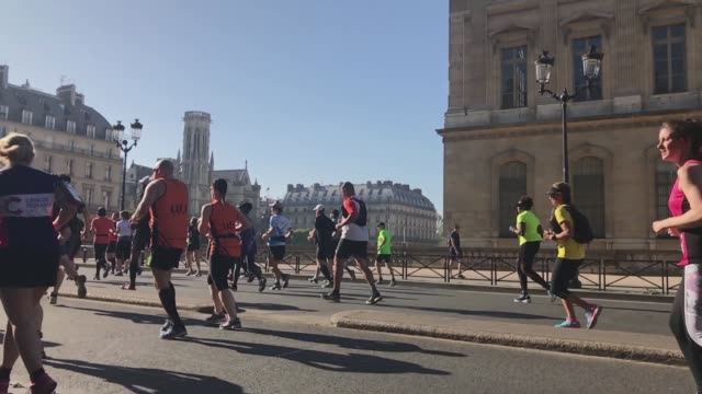 Runners at rue de Rivoli in front of Louvre during the sport event Paris Marathon 2017