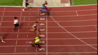 HA WS Runners crossing finish line on sports track/ Sheffield, England