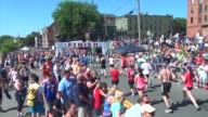 Runners finish race to the cheers of a large crowd
