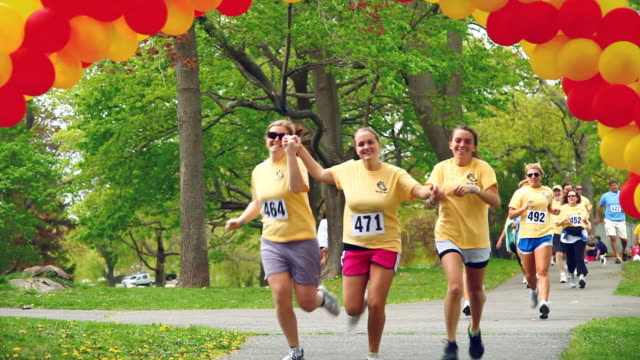 WS Runners finishing charity fun run / Salem, Massachusetts, USA