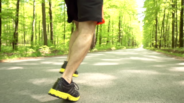 HD SUPER SLOW-MO: Runner's Footwear On Forest Road