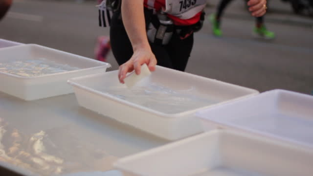 Runners grab water to refresh during race