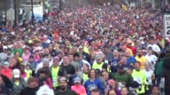 15000 runners head to camera in running road race close up then zoom out