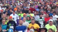 15000 runners head to camera in running road race close up