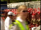 Runners in 2007 London Marathon Hundreds of competitor medals hanging on rack for collection by those who have completed race More of competitors...