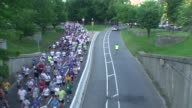 Runners in road race Leaders out and mass follows out and back