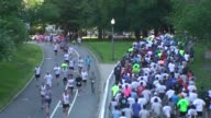 Runners in road race mass out and back