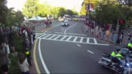 Runners in road race Start of race to camera